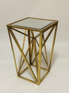 Metallic end table for lounge area